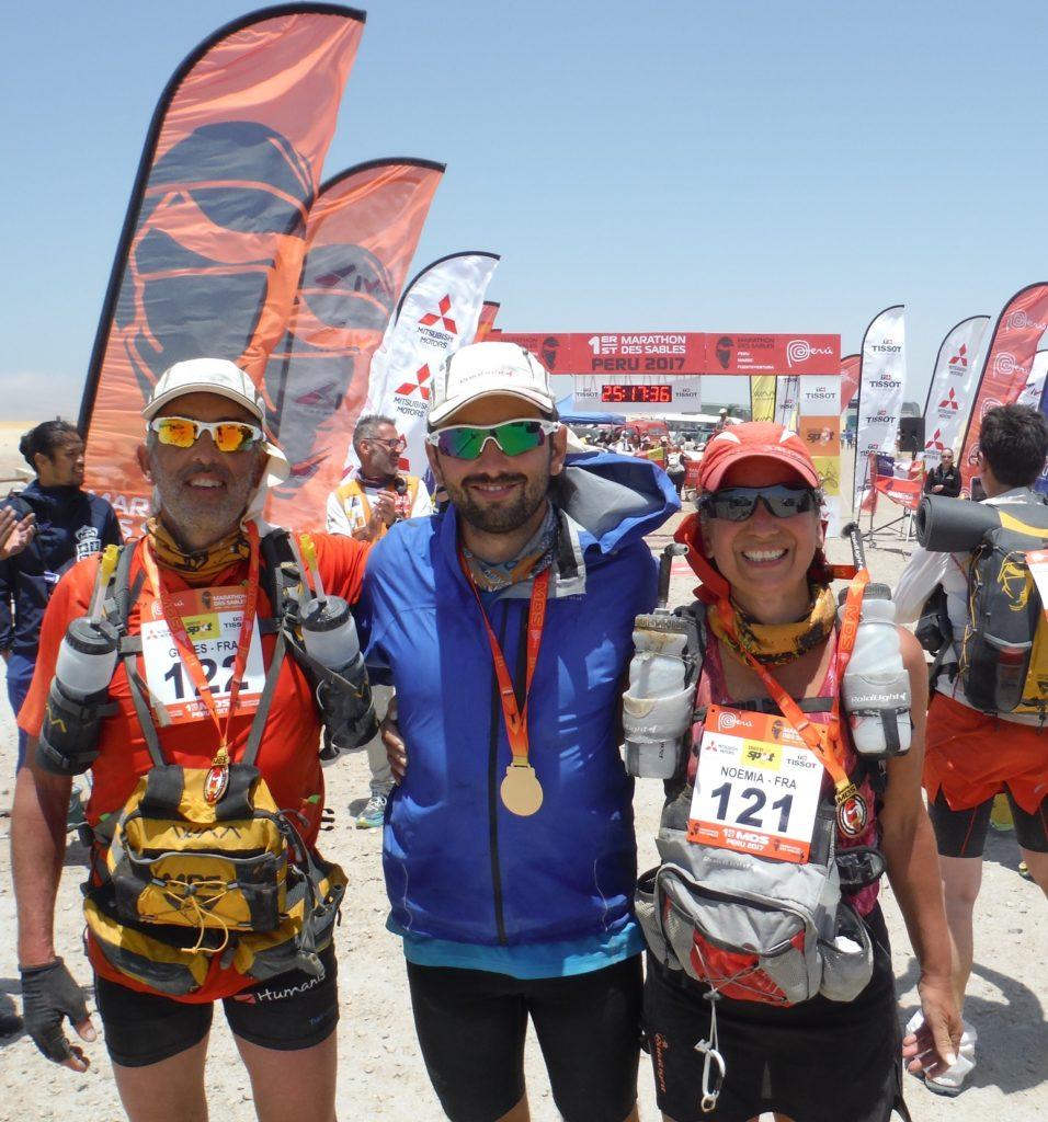 Noémia, dossard 121, son mari, dossard 122, tous deux à l'arrivée et médaillés, leur fils aussi pour l'assistance.